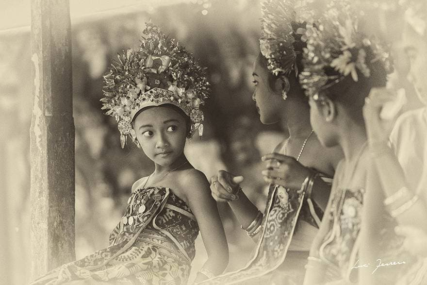 Girls in the village of Tenganan Pegringsingan prepare to perform the sacred Rejang dance